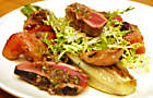 Marcus Samuelsson's Salt-Cured Squab with Bacon-Wrapped Plums & Frisee Recipe | D'Artagnan