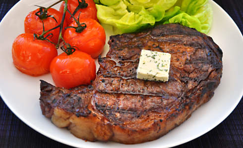 Grilled Ribeye Steak with Basil Butter