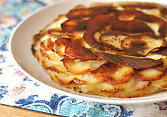 Crispy Potato Cake cooked in black truffle butter and duck fat recipe | D'Artagnan